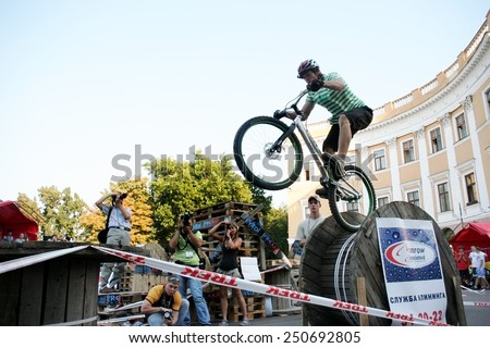 Odessa, Ukraine - July 28, 2007: Young male jumping freestyle and doing acrobatic tricks at a bike trial. BMX, MTB - stock photo