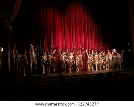 Odessa, Ukraine - June 2, 2013: Actors on stage the ballet Firebird on the stage of the Odessa National Opera and Ballet Theatre. Dancers and dancers in colorful costumes during show, moving motion