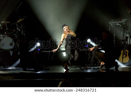 ODESSA, UKRAINE - 20 June 2014: in a nightclub at a concert during the creative light and music show. stage smoke on a club party. Singer Tina Karol Ukraine and her jazz band