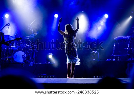 ODESSA, UKRAINE - 20 June 2014: in a nightclub at a concert during the creative light and music show. stage smoke on a club party. Singer Tina Karol Ukraine and her jazz band - stock photo