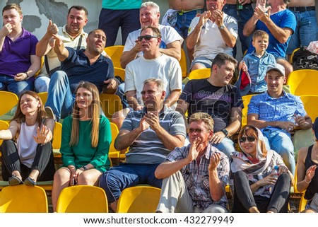 Odessa, Ukraine - June 5, 2016: Spectators and fans in the stands of the stadium during the World Cup rugby in Europe. Moldova - Ukraine. Viewers react emotionally support your favorite team!