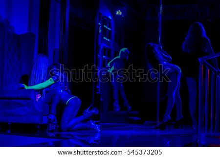 ODESSA, UKRAINE - June 6, 2015: Striptease bar. Young sexy girls in strip club luring visitors to the lap dance.  striptease clubs are gaining popularity in a period of crisis in the country