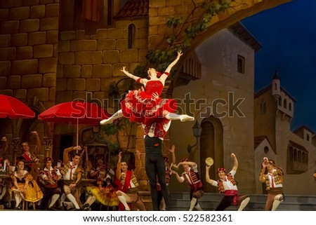 ODESSA, UKRAINE - June 6, 2013: The actors on stage of ballet Don Quixote on stage of Odessa National Opera and Ballet Theatre. Dancers and dancers in colorful costumes during show, moving motion