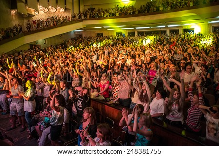 Odessa, Ukraine - June 20, 2014: The audience at a concert during the creative light and music show fashionable jazz band - stock photo