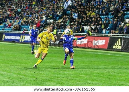 ODESSA, UKRAINE -24 March 2016: A friendly game between the national football team of Ukraine (yellow) and the national team of Cyprus (blue). Game moment of intense soccer match.