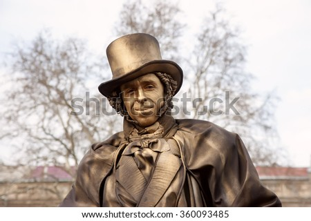 Odessa, Ukraine - March 31, 2013 Live sculpture of a man, dressed in 19th century costume. The festival of live sculptures - stock photo