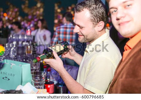 Odessa, Ukraine March 6, 2017: People make selfy, drink alcohol, dancing, smiling, smoking hookah and kissing during concert in night club party. Man and woman have fun at club
