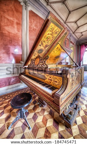 Odessa, Ukraine - 28 March 2014: Scientists House was built in 1830. Grand Royal Piano with Barocco Style in Red Room. - stock photo
