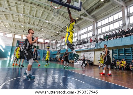 ODESSA, UKRAINE - March 19, 2016: Ukrainian Cup Basketball. Wrestling tournament leaders team Superleague Odessa and Mariupol. Rigid emotional for the ball near the basket ring.