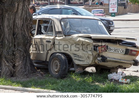 Odessa, Ukraine - May 3, 2015: A car accident in the city center. The driver lost control of the car and crashed into a tree - stock photo