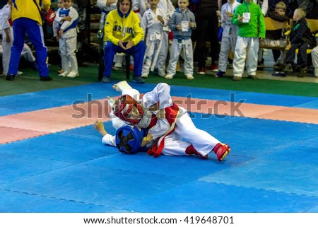 Odessa, Ukraine - May 6, 2016: World Championship Karate and Kobudo among children and adult athletes. Top fighters karate school in kimono show their skills take fight to mat. World Champions Battle