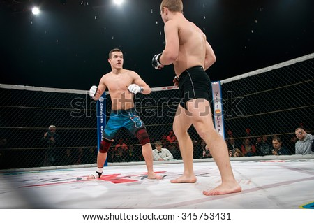 Odessa, Ukraine - November 24: Athletes compete in the MMA cage, resulting in punching, kicking and wrestling. The dramatic moment of battle November 24, 2015 in Odessa, Ukraine