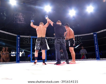 """Odessa, Ukraine - 24 November 2015: Athletes in the ring extreme Sport mixed martial arts competition tournament series """"World MMA Network MAXMIX"""".  - stock photo"""