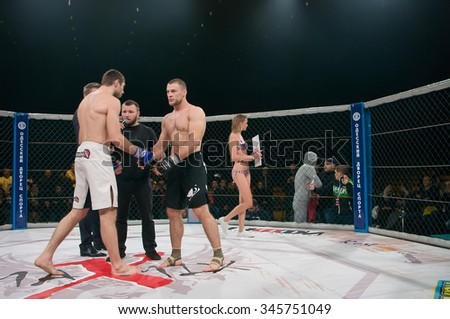 Odessa, Ukraine - November 24: Athletics MMA mixed martial arts fighters to compete in the cell, resulting in punching, kicking and wrestling. , November 24, 2015 in Odessa, Ukraine - stock photo