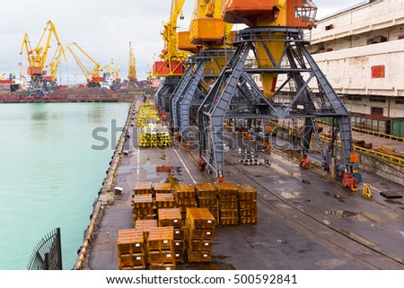 Odessa, Ukraine - October 13, 2016: Container cranes in cargo port terminal, cargo cranes without job in an empty harbor port. A crisis. Defaulted paralyzed entire economy