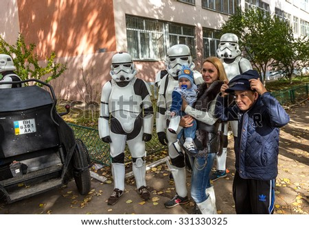 Odessa, Ukraine -25October 2015: Darth Vader stormtroopers just communicate with humans photographed with children. Fictional characters Star Wars appeared in real life in  elections to local councils