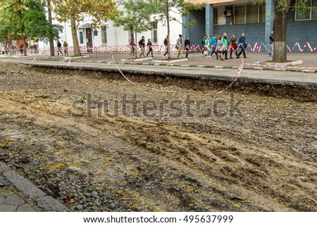 Odessa, Ukraine - 9 October 2016: The road is closed. Road repair. Overhaul of city road and tram line. Engineering road building and utility communications. Repair and reconstruction of city square