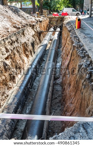 Odessa, Ukraine - Sept. 29, 2016: Major overhaul and replacement of major urban heat pipes. Replacement of old rusted and leaky water pipes. New technologies in engineering communal municipal services