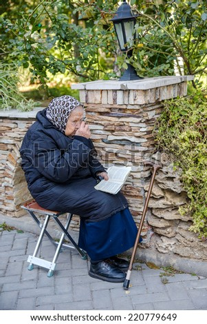 ODESSA, UKRAINE - SEPTEMBER 29: Old woman Orthodox parishioner during the celebration of 190 years of the Odessa Monastery September 29, 2014 in Odessa, Ukraine