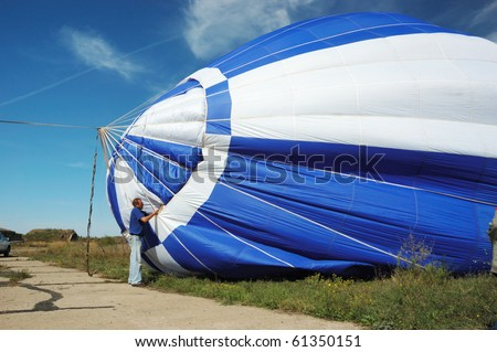 ODESSA, UKRAINE - SEPTEMBER 11: Pilot is preparing for the launch balloon in the air,First Odessa's Balloon Festival on September 11, 2010 in Odessa, Ukraine - stock photo