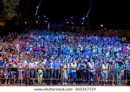 Odessa, Ukraine - September 2, 2015: The audience at a concert during the creative light and music show fashionable jazz orchestra. Night scene, the audience emotionally watching a concert - stock photo