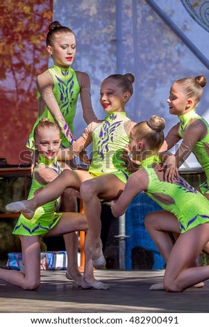 ODESSA, UKRAINE -10 September 2016: Young participants of urban dance and sports clubs shown live on stage at Day of Physical Culture and Sports. Children on stage. Dance little girls on stage