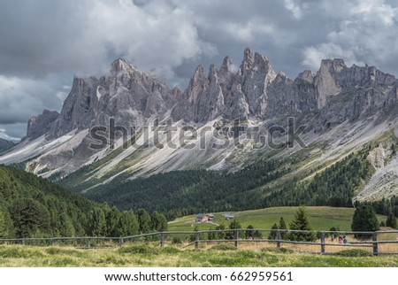 Odle mountain massif, Puez-Odle nature park-August 20, 2015: Hikers crossing Brogles pass on the way to/from Brogles refuge, hiking from/to the town of Ortisei in Gardena valley, Dolomites, Italy