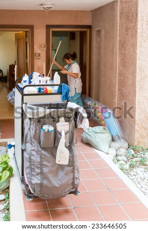 OELUEDENIZ, TURKEY - OCTOBER 20, 2014: A maid is cleaning a luxury hotel apartment in the holiday resort Lykia World on October 20, 2014 in Oeluedeniz, Turkey - stock photo