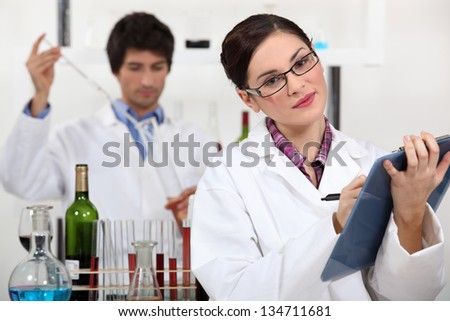 Oenologists analysing a wine - stock photo