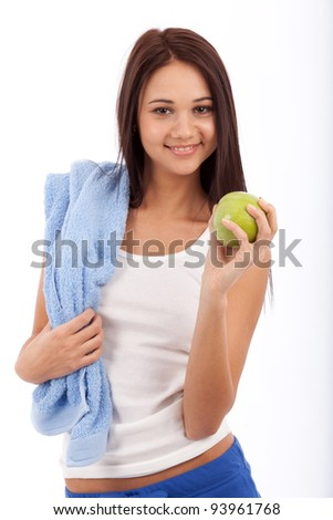 of beautiful young girl holding green apple isolated on white