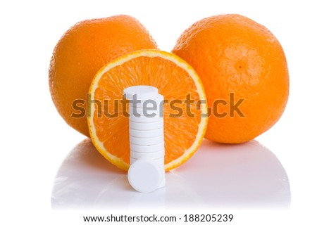 of orange and pills isolated - vitamin concept - stock photo