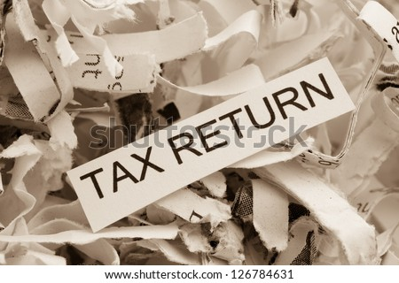 of paper with the heading tax return, symbol photo for data destruction policy and tax law - stock photo