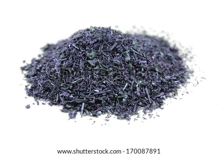 Potassium Permanganate Crystals On White Background Stock Photo