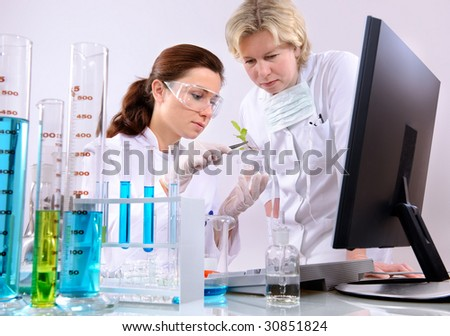 of scientists working at the laboratory - stock photo