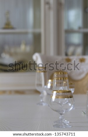 Of the table in the dining room with a glass closeup.