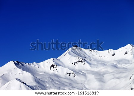 Off-piste slope and blue clear sky in nice winter day. Ski resort Gudauri. Caucasus Mountains, Georgia. - stock photo