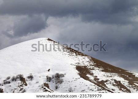 Off piste slope and overcast gray sky. Caucasus Mountains, Georgia, ski resort Gudauri. - stock photo