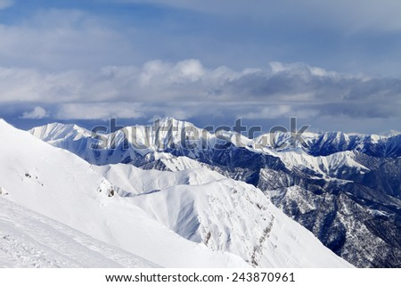 Off-piste slope and snowy mountains. Caucasus Mountains, Georgia, ski resort Gudauri. - stock photo