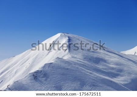 Off piste slope at sun day. Caucasus Mountains, Georgia, ski resort Gudauri. - stock photo