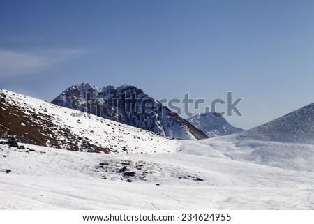 Off piste slope at sunny day. Caucasus Mountains. Georgia, ski resort Gudauri. - stock photo