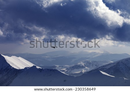Off-piste slope for heliskiing and helicopter in evening mountains. Ski resort Gudauri. Caucasus Mountains, Georgia. - stock photo