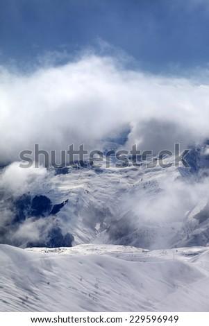 Off-piste slope in fog. Caucasus Mountains, Georgia, ski resort Gudauri. - stock photo