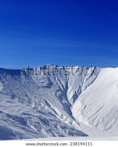 Off-piste slope with traces of avalanche in sun morning. Caucasus Mountains, Georgia. Ski resort Gudauri. - stock photo