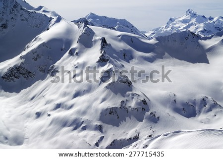 Off piste snowy slopes of Caucasus Mountains. View from the slope of Mount Elbrus - stock photo