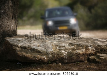 off-road car driving off-road in natural dirt terrain - stock photo