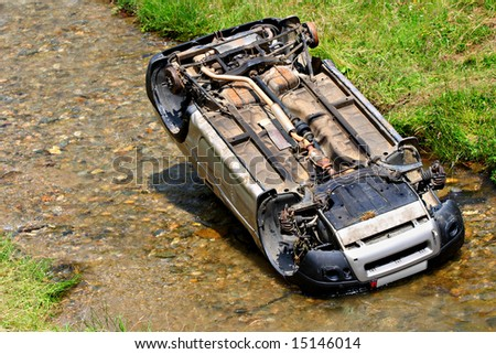 Off road car fallen in river - stock photo