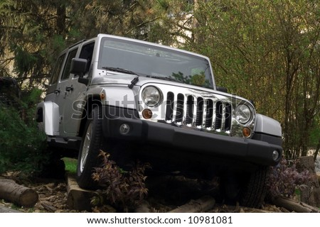 Off road car in forest - stock photo