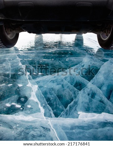 Off-road car rally on ice of lake Baikal in winter - stock photo