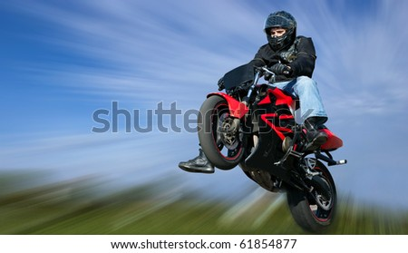 Off-road rider is jumping - stock photo