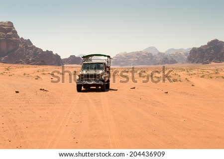 Off road vehicle driving in the wadi rum desert from jordan - stock photo
